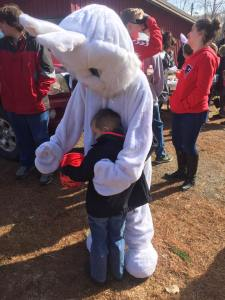 Easter Bunny greets a child at the Pinnacle